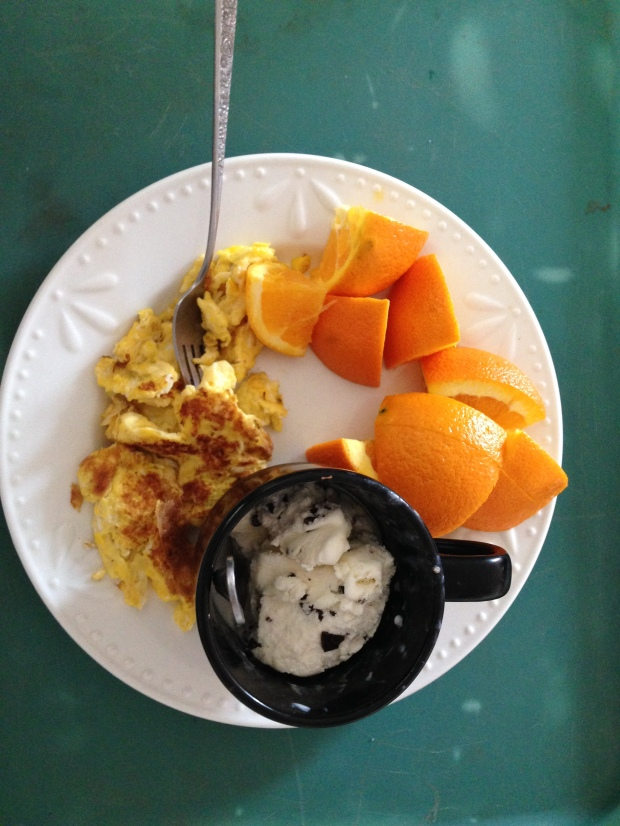 Breakfast of Champions & Warriors. Oranges, scrambled eggs, and ice cream prepared by Ireland. She had the first and last bites of my ice cream...and several in between!
